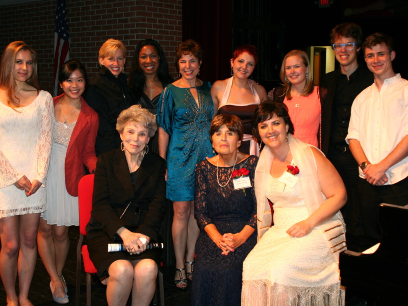 "Alumni performers pose with Nelly Berman, Elena Berman, Mrs. Kligerman, and Andrea Solomon after the 2013 ""Celebrating Nelly"" concert."